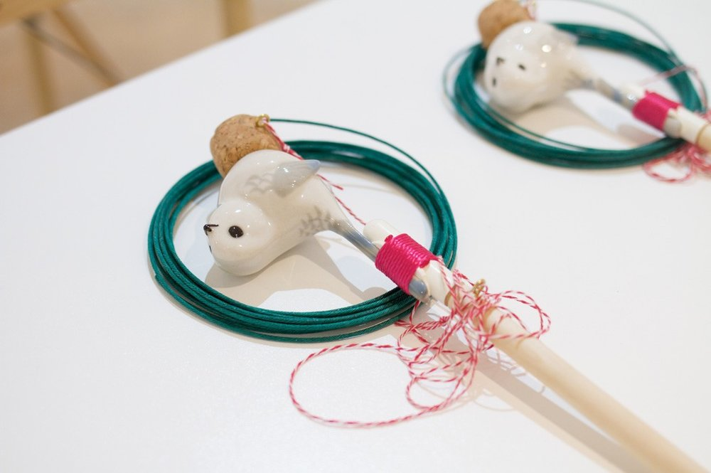 Smoke Bomb  Porcelain Tomtit, wooden spoon, ping pong balls, Champagne cork, fuse, thread, silicon, paint; 2014