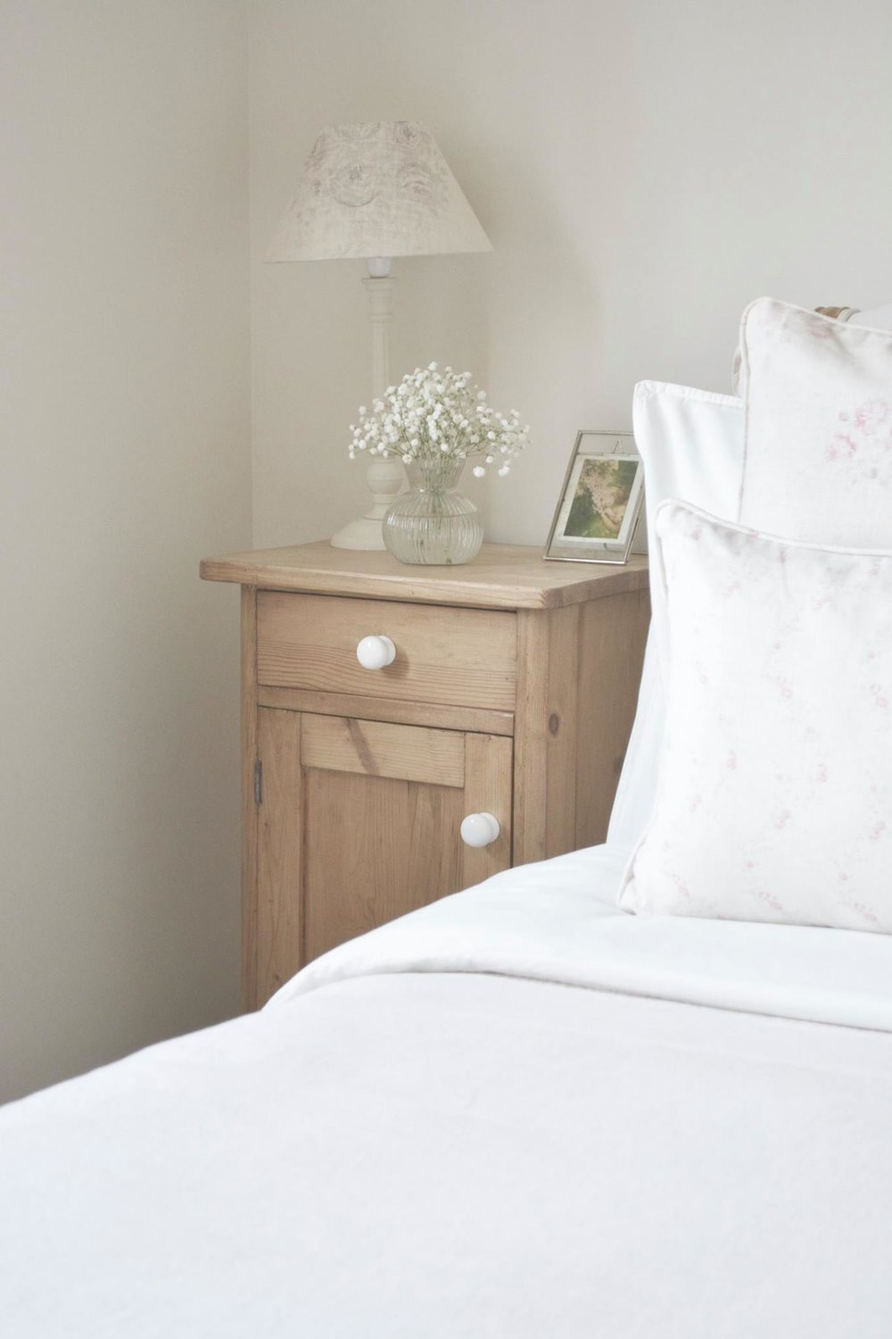 Cottage Bedroom with faded floral linens designed by www.hlinteriors.co.uk7.jpg