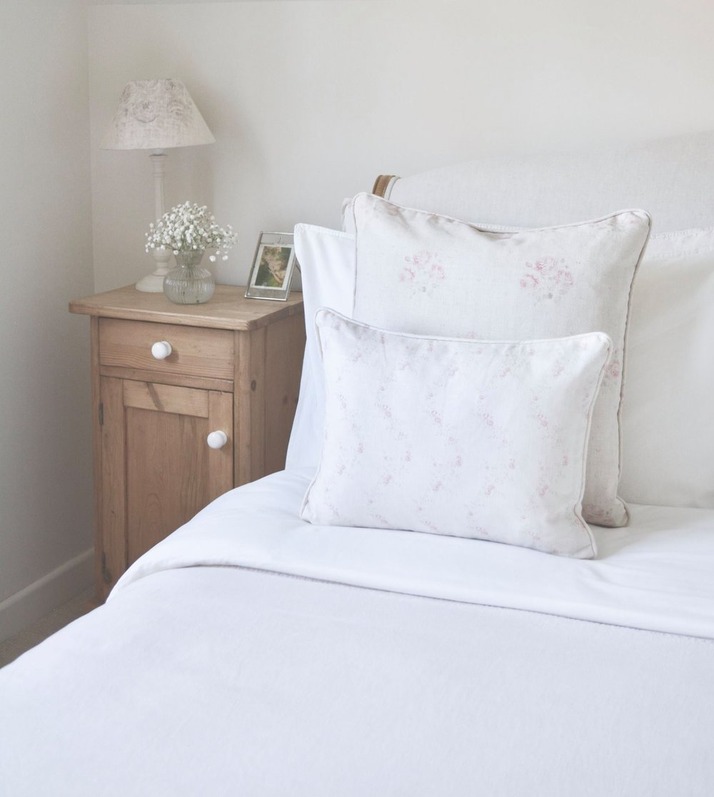 Cottage Bedroom with faded floral linens designed by www.hlinteriors.co.uk14.jpg
