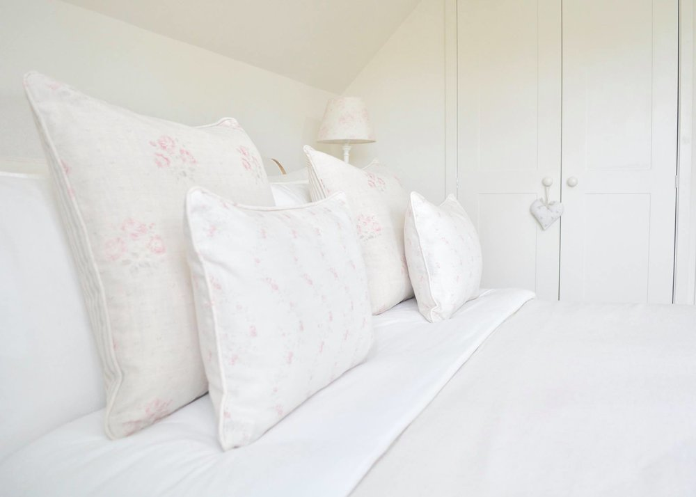 Cottage Bedroom with faded floral linens designed by www.hlinteriors.co.uk21.jpg