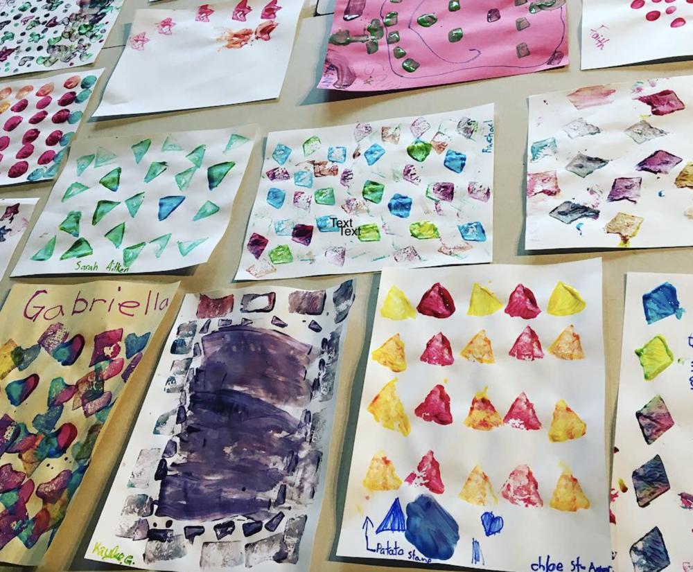 Grade 4 students engage in potato stamping (Nov. 8, 2018)