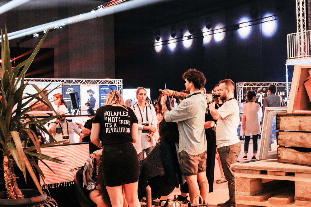 How about free haircuts? It will definitely keep people around for long. Okay, that might not suit many brands or contexts, but it can serve as inspiration to create an experience for the people who visit your booth.