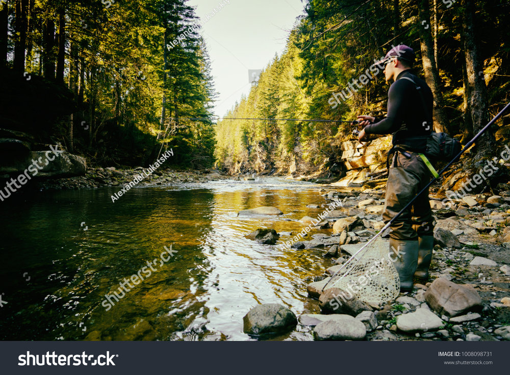 stock-photo-fisherman-on-a-beautiful-mountain-river-in-the-forest-1008098731.jpg