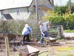 The raised beds start to take shape and Caroline and Paul barrow the soil to fill them.