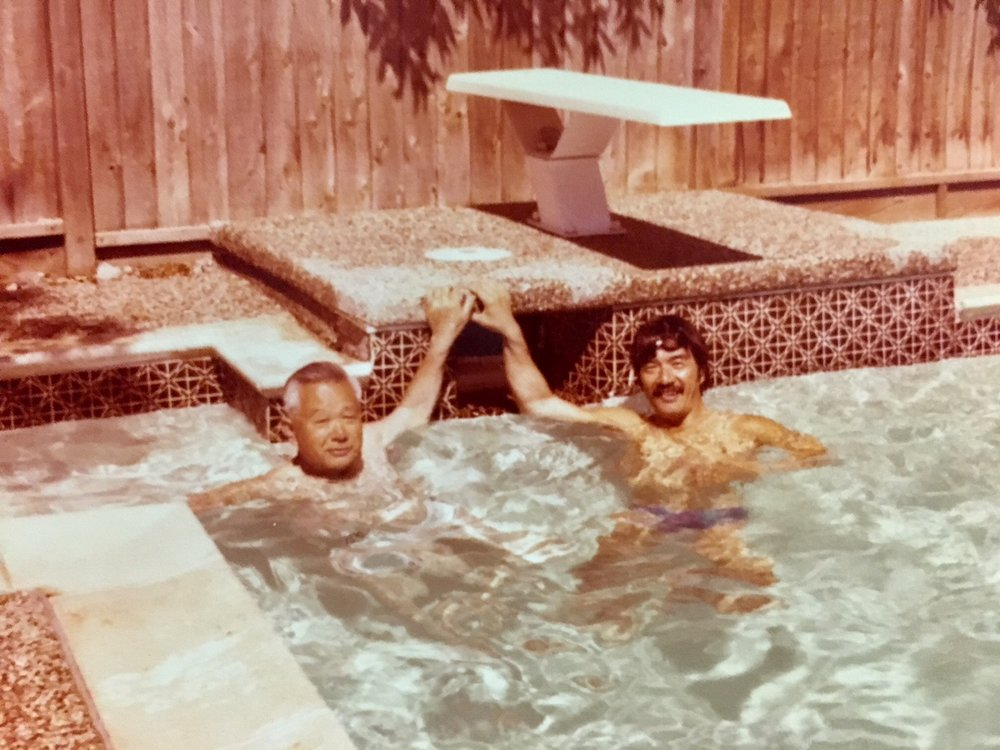Diana's grandfather and dad swimming