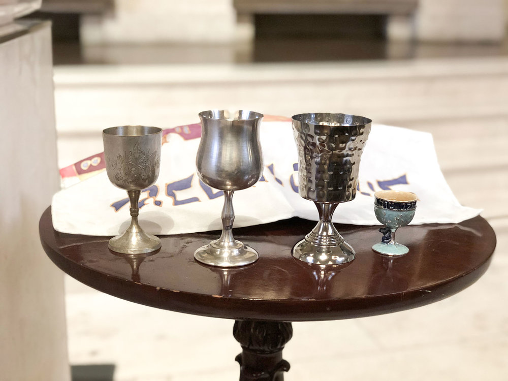 Kiddish cups of the four adult b'nei mitzvah students