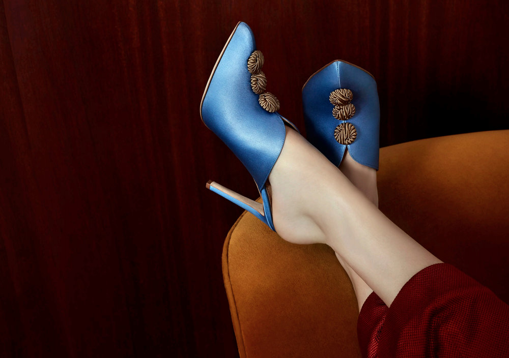 The Louise: Blue satin mule with a stiletto heel and decorative silk buttons. Coming soon.