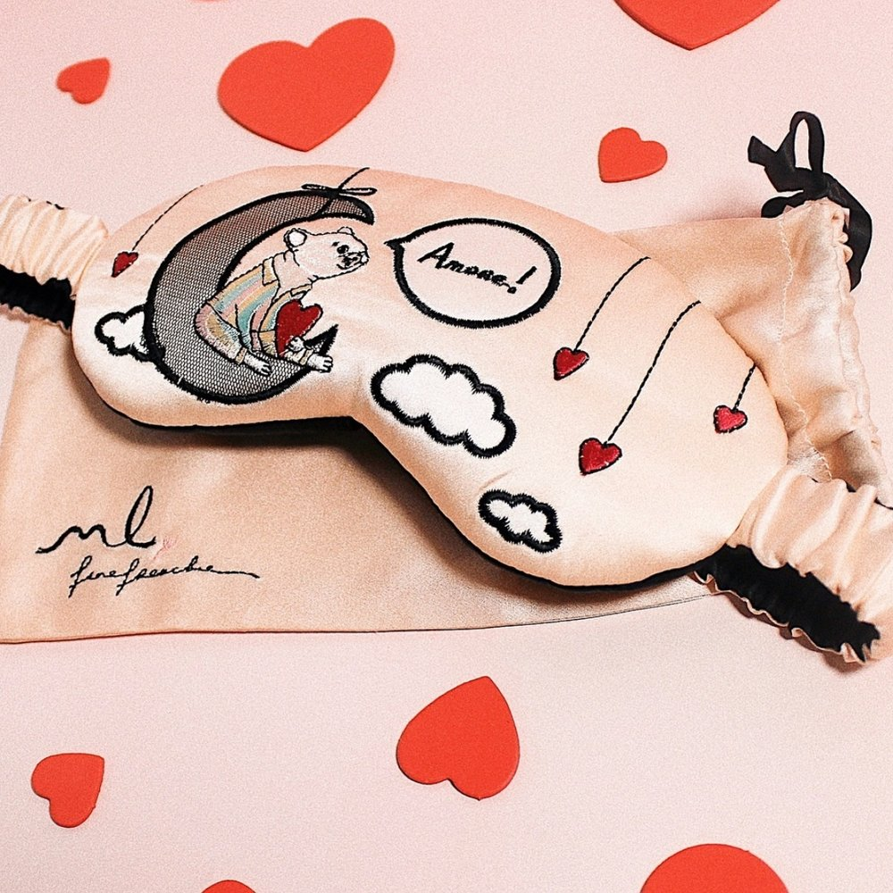 A collaboration between Morgan Lane and The Fine Frenchie, this silk eye mask is embroidered with an illustration of the eponymous bulldog in Morgan Lane pyjamas, lounging on a crescent moon.   Morgan Lane x The Fine Frenchie Amoré mask, $110,    Morgan-lane.com