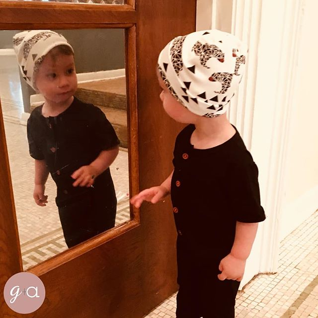Look at this hunk rocking his Calvin rompo paired with his Theo beanie. This is the perfect fall oufit for any little boy! Grab this pair today for your little man!