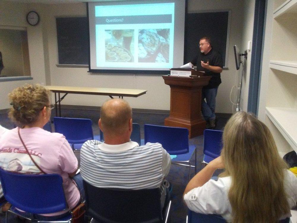 Dennis McIntosh speaking at shellfish growers meeting.
