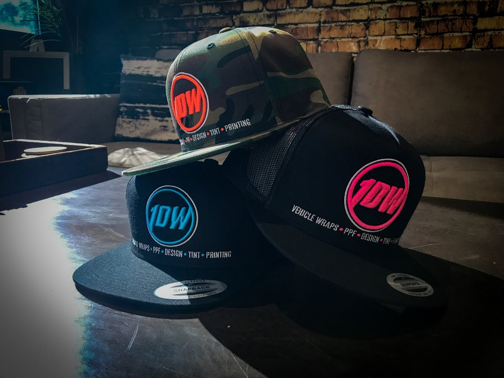 1DW Snapbacks are now available for purchase in store only for $25