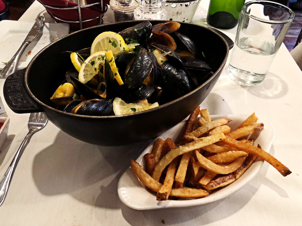 Les Moules  P.E.I mussels cooked in marinière sauce, traditionally served with French fries