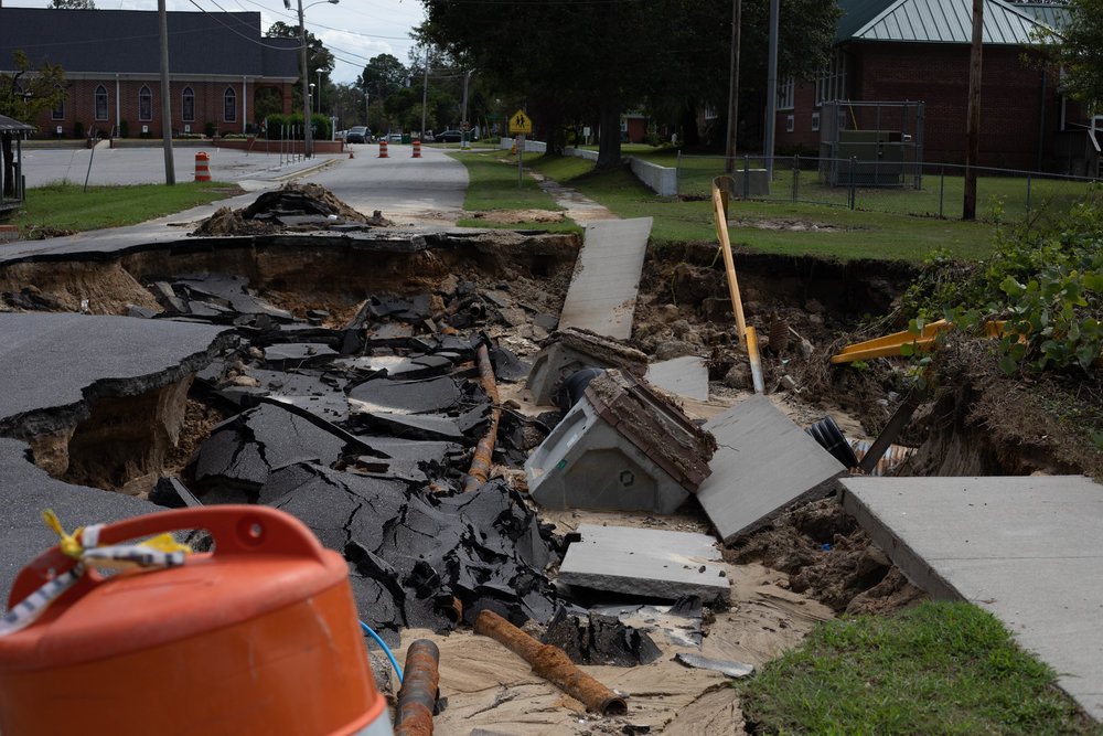 The road in front of the Hargrave Elementary School that completely sunk. School was canceled for over a month after both hurricanes.