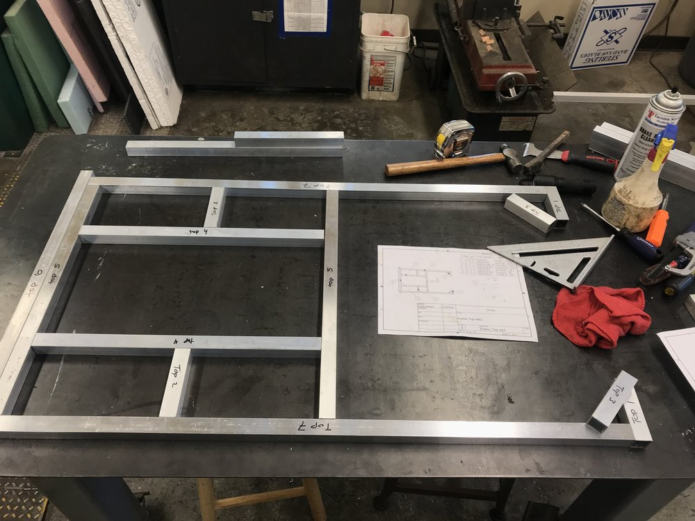 Top of the frame being prepped for welding, shown with corresponding assembly drawing