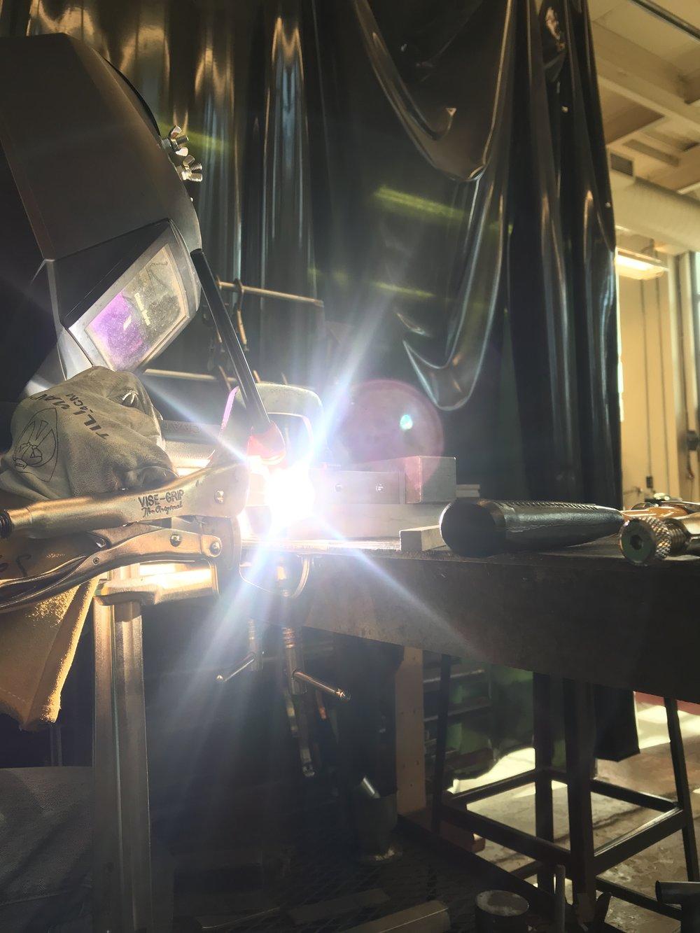 TIG welding a segment of the aluminum frame