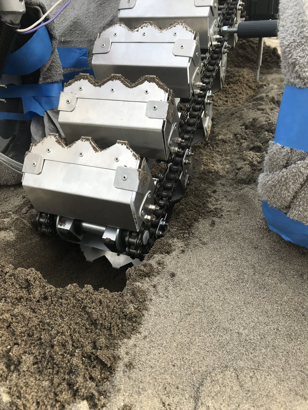 Digging through sand during bucket chain validation testing
