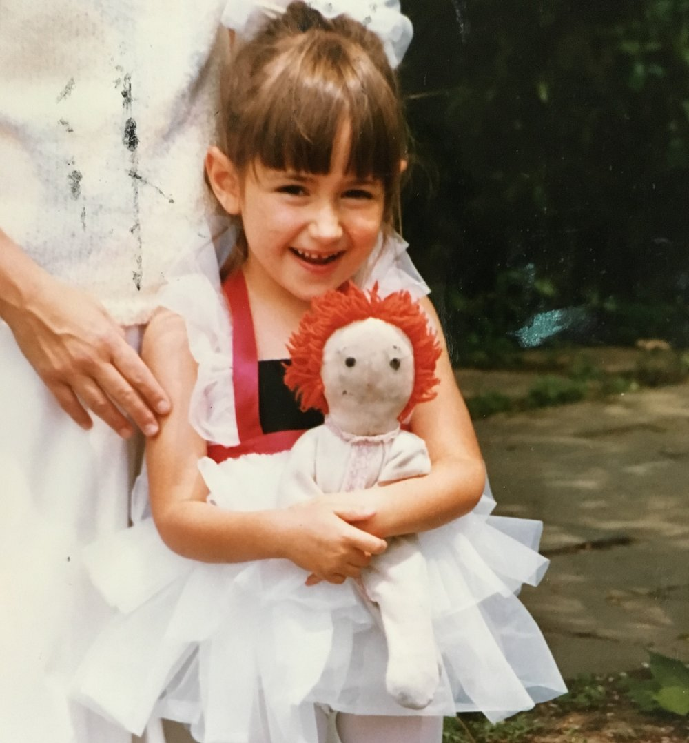 Rachel, age 5, with one of her favorite dolls.