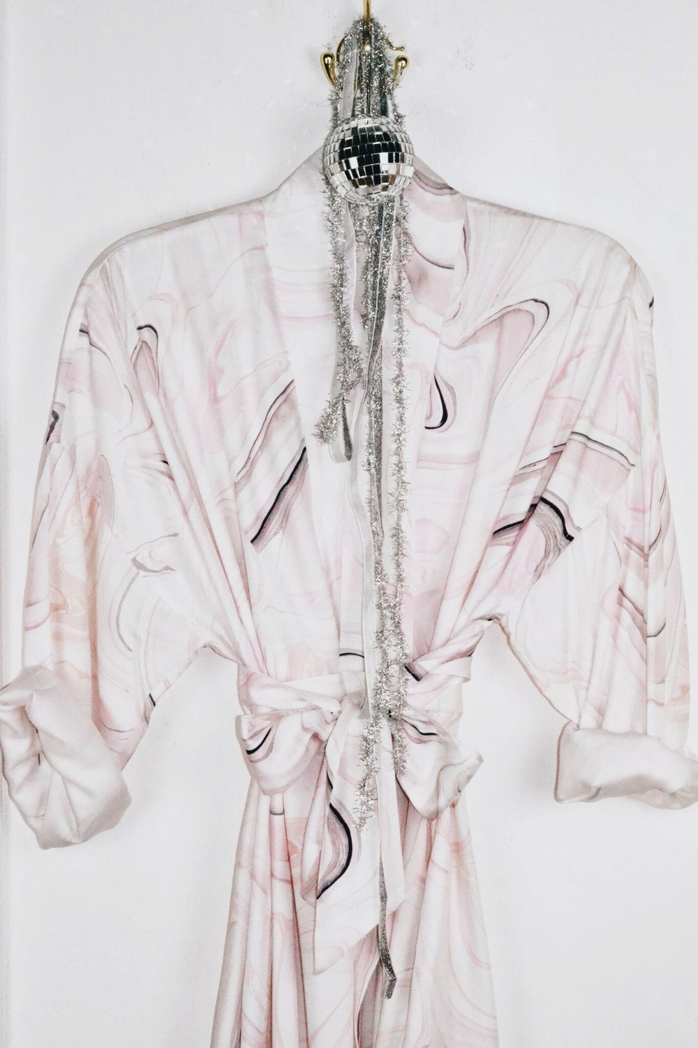sunday forever uLTRA LIMITED EDITION FANCY MARBLE KIMONO - It wouldn't be a holiday without a Sunday Forever Kimono. Yes, we're biased (we live in them) but there's a reason why these little babies have a cult following. You can read about our Fall 18 design process in our piece, Sunday Forever Fall 2018 Collection: From the Sheets to the Streets. And, if these little magical garments weren't all that already, you can now get them...CUSTOMIZED. This isn't your mother's housecoat, obviously.$200