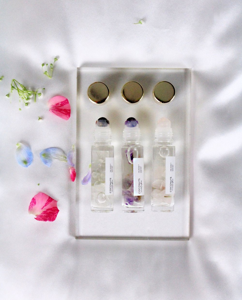 "For friend love - St. Valentine (you, in this scenario) wore an amethyst engraved with the image of his loyal assistant, Cupid (your friend, in this scenario). Amethyst is synonymous with February and Valentine's Day, so it's makes sense you'd want to honor your friendship with Sunday Forever's Coconuts Perfume Gemstone Rollerball Set. A set of three Coconuts Perfume Rollerballs (1 Amethyst, 1 Rose Quartz and 1 Tiger's Eye) made even more magical with tiny floating crystals! Give them all to your loyal sidekick or hand them out like you're Oprah (""YOU get a rollerball and YOU get a rollerball!"")."