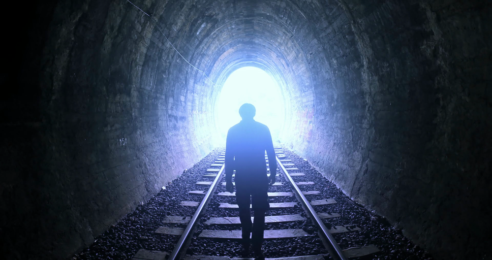 man-goes-by-railway-tracks-through-dark-tunnel-toward-bright-light-in-the-end_bi7r2o1ex_thumbnail-full01.png