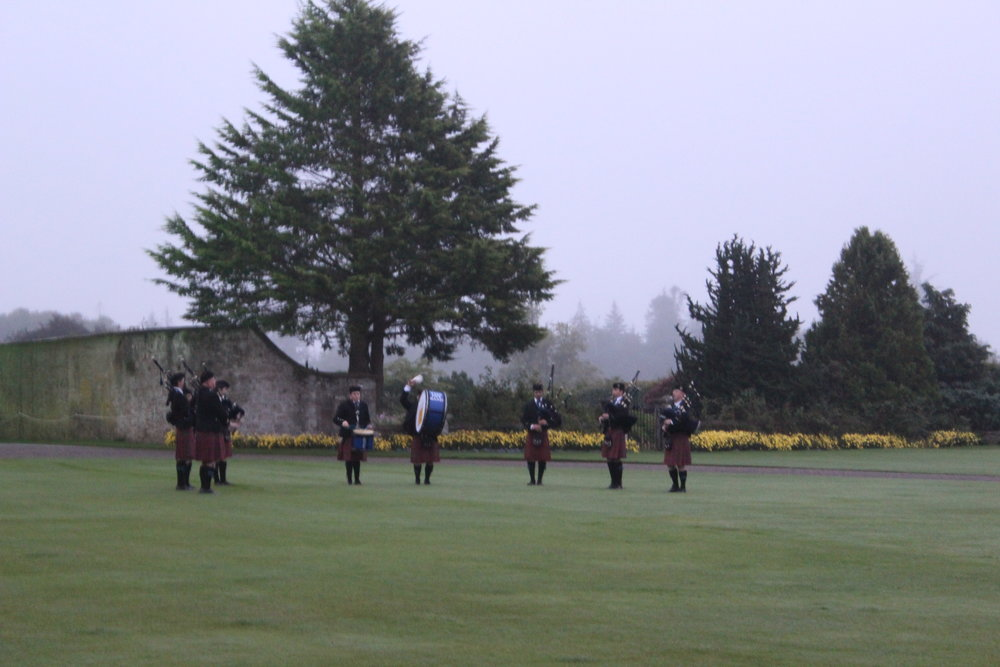 Bagpipers on the front lawn