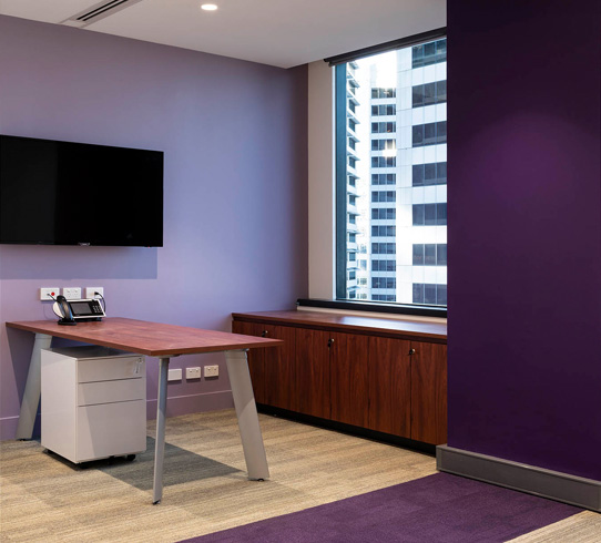 ConnectWise - Working with design partners in Florida, Urban Fitouts delivered 500m2 of office space for the US based ConnectWise. Situated in a highly sought after tenancy at 1 Market Street, 14 different carpet and paint colours were employed to vivid effect in this makeover with the incorporation of unique granite benchtops adding texture and weight to the design. The spaces delivered included reception, front of house, meeting rooms, breakouts, 70 workstations and quiet spaces.