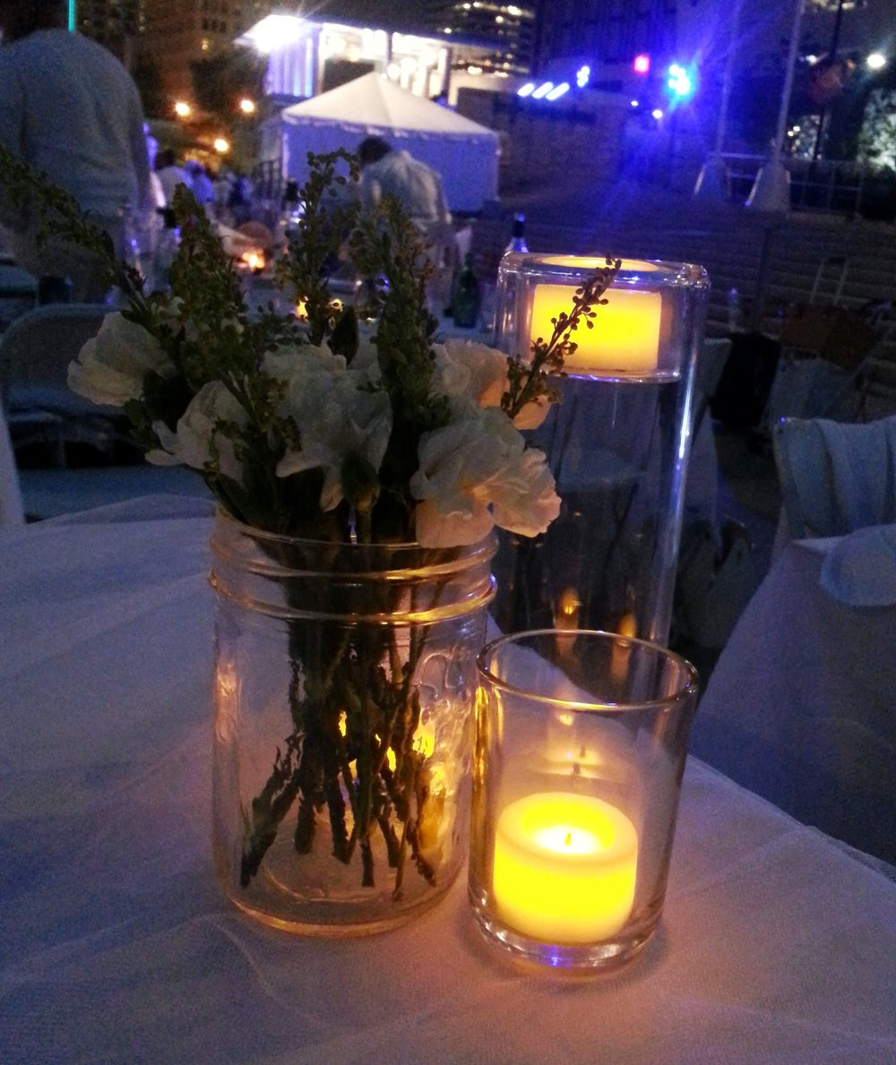 You will want light in the later parts of the evening, because it does get dark (also notice, there's no water in that jar of flowers - easier to carry that way).