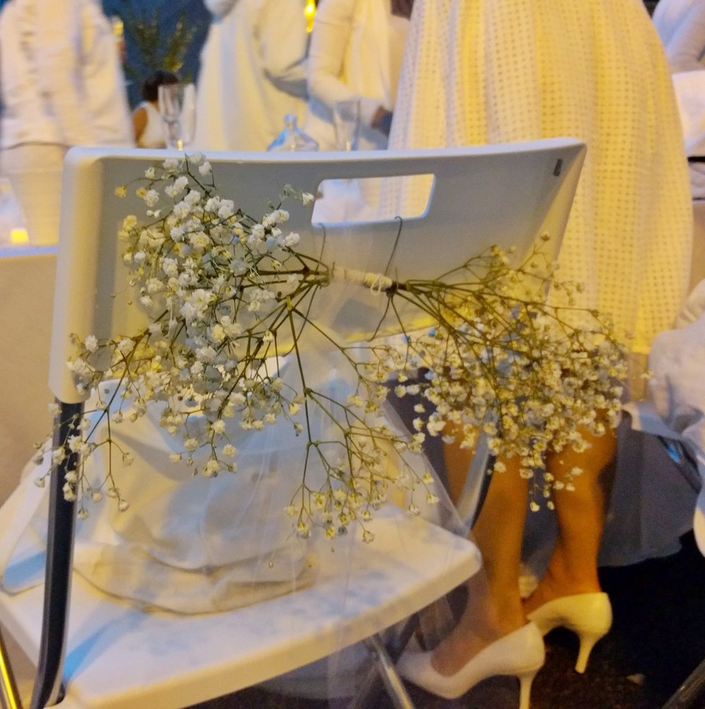 Tulle streamers and bunches of flowers for chair backs - easy to do, and saves table space for delicious food.
