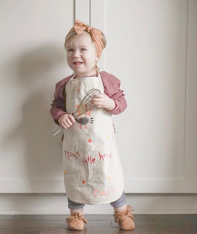 picked this little nugget up from daycare + she had on this adorable apron! going to put her little bum to work tomorrow, thinking she can be in charge of potatoes + pie. think she can handle it?
