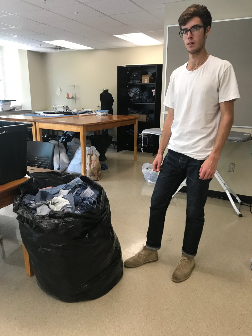 Pictured: Greg, coming in at 6'1'' vs one very large bag of scraps.