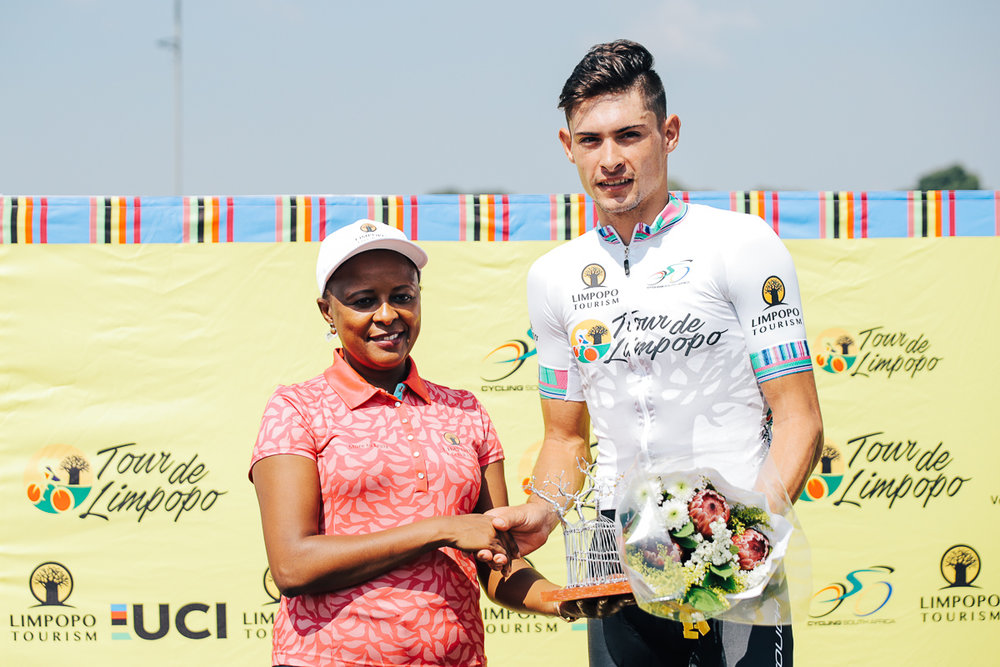 Ms Sonto Ndlovu (Limpopo Tourism Agency CEO) congratulates Gustav Basson (ProTouch Sports) on his victory and for earning the white jersey for the Best Young Rider on Stage 1 of the Tour de Limpopo from Polokwane to Tzaneen on Monday 23 April 2018 © HaydsBrown