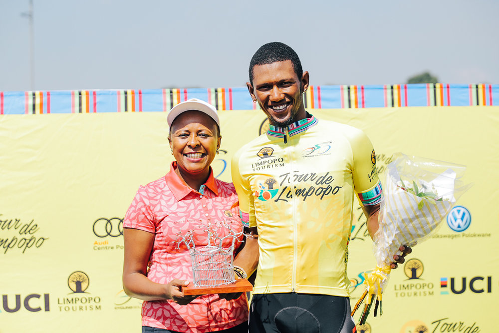 Ms Sonto Ndlovu (Limpopo Tourism Agency CEO) congratulates Clint Hendricks (Team BCX) for winning the coveted yellow jersey for the lead in the overall General Classification on Stage 1 of the Tour de Limpopo from Polokwane to Tzaneen on Monday 23 April 2018. Hendricks was also awarded the Sprinters' green jersey. © HaydsBrown
