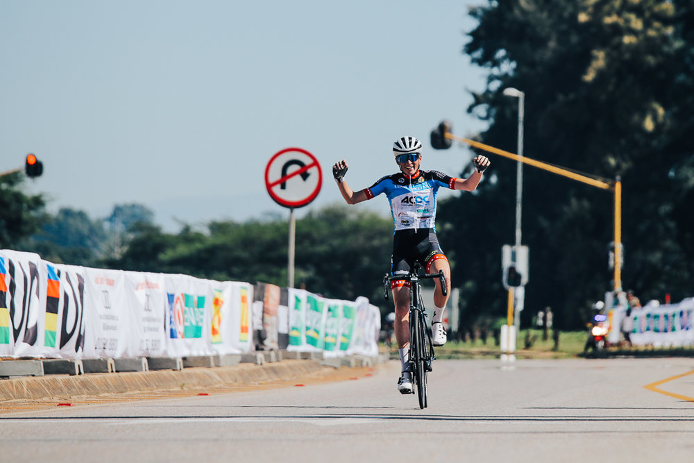 Victorious with both hands raised high, young Andrew Edwards (ACDC Luso) crossing the line after a solo breakaway in the final kilometres on Stage 2 of the Tour de Limpopo from Tzaneen to Tzaneen on Tuesday 24 April 2018 © HaydsBrown