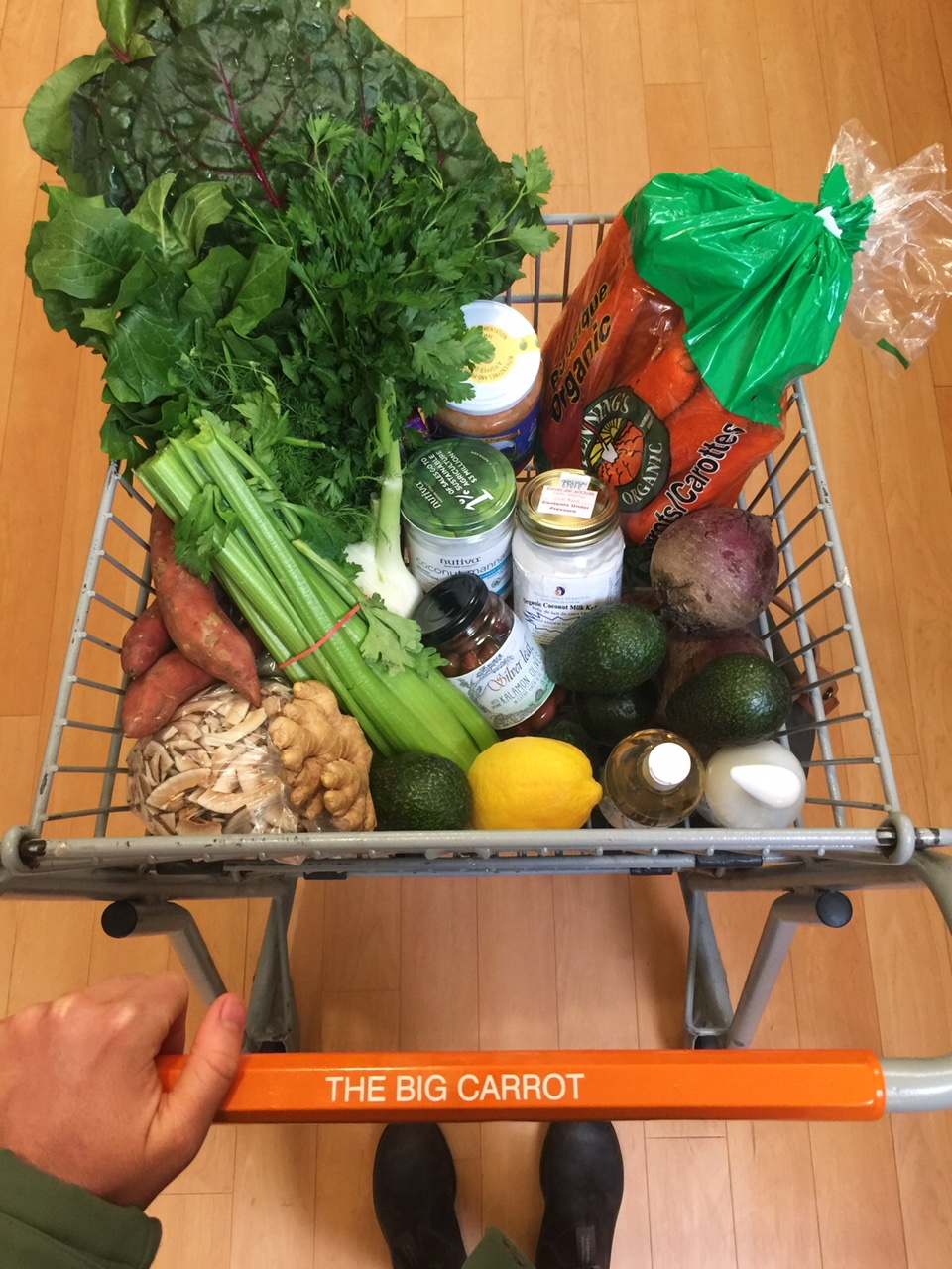 Grocery cart full of organic vegetables and fermented goods to nourish my body post-fast