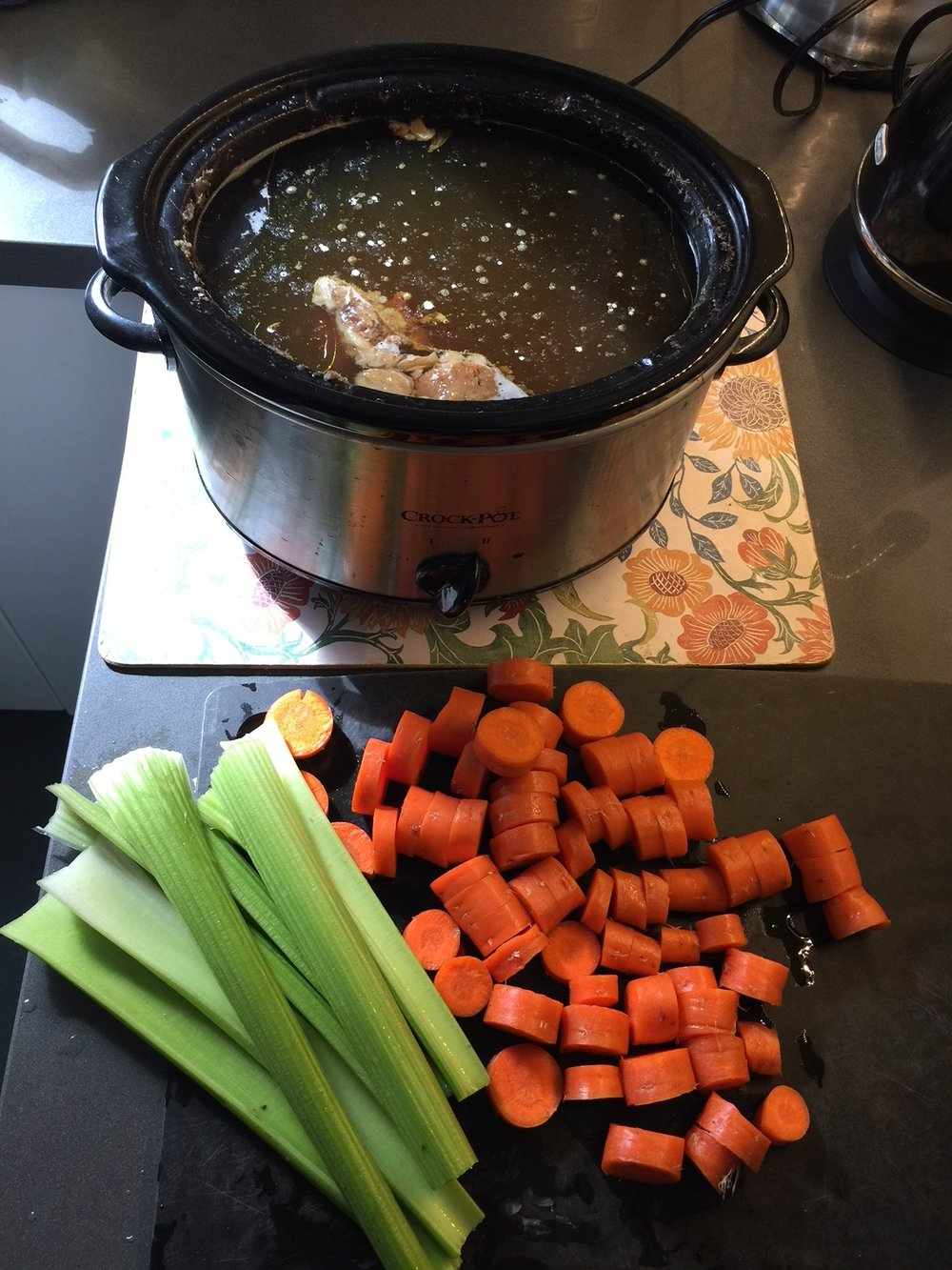 After simmering my bone broth for 48 hours, I strain the broth (keeping the marrow) and then add in some veggies to cook for a few hours. Turning the broth into more of a broth-based soup.