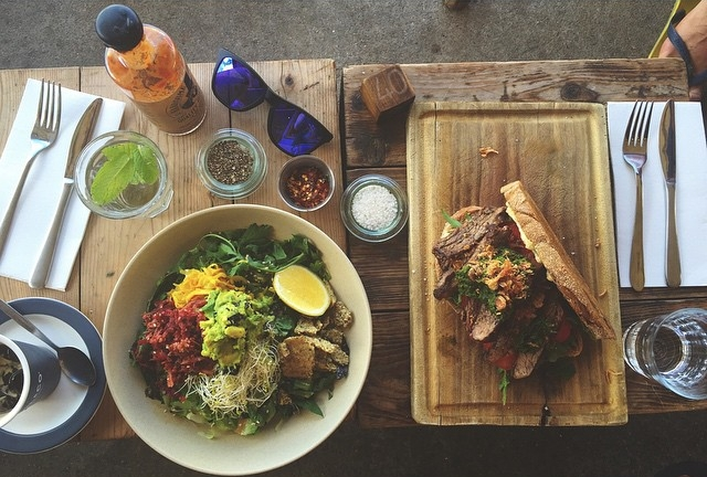 A big green bowl + steak sandwich from Porch and Parlour.