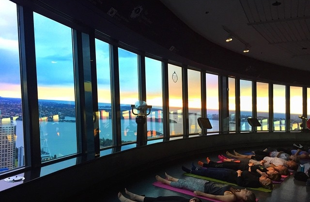 Sunrise yoga overlooking the harbour,atop the Sydney Tower Eye.