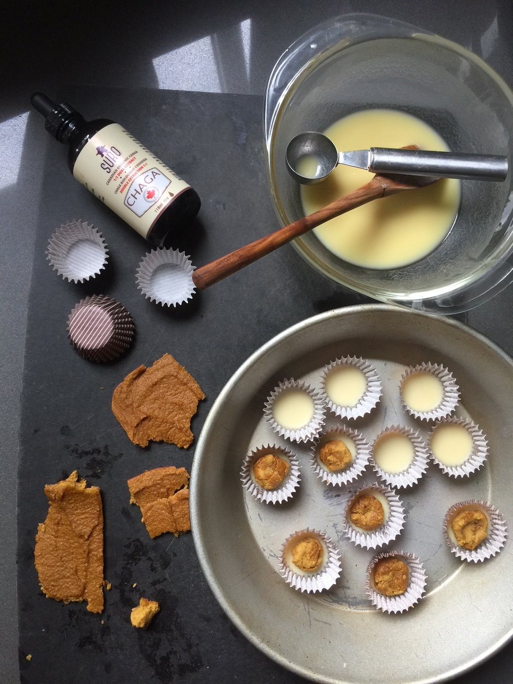 After setting the bottom layer of chocolate, place pumpkin pie filling in each cup.