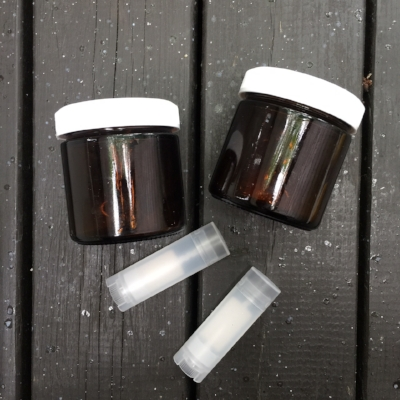 Darker containers (miron, amber, or blue) will preserve the integrity of the oils better than regular glass. You can also buy empty lip balm containers (or even better- reuse an old one!)