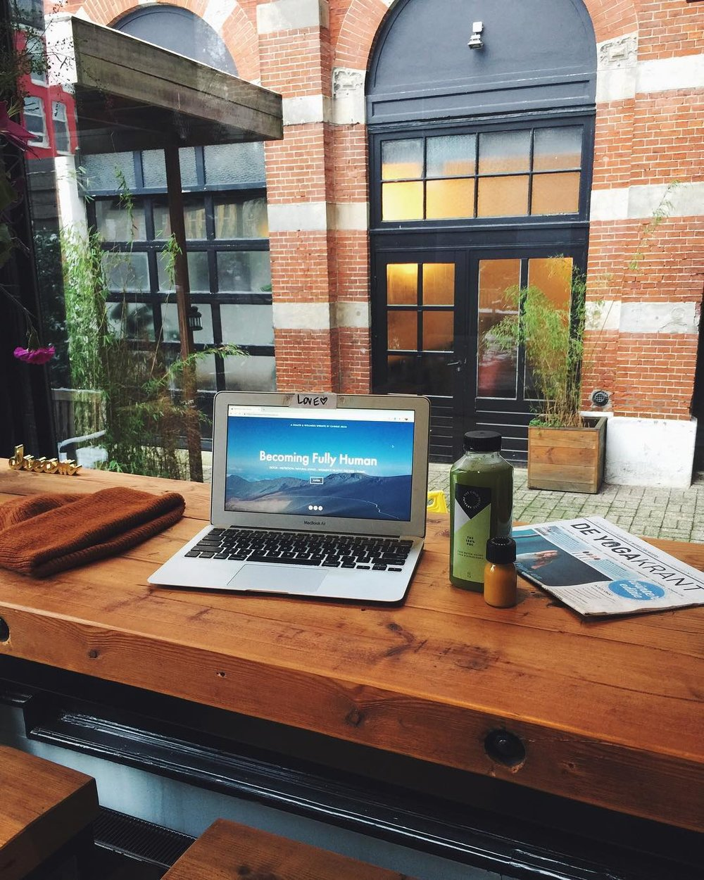 Getting some work done in the lobby of a yoga studio in Amsterdam, before a hot yoga class.