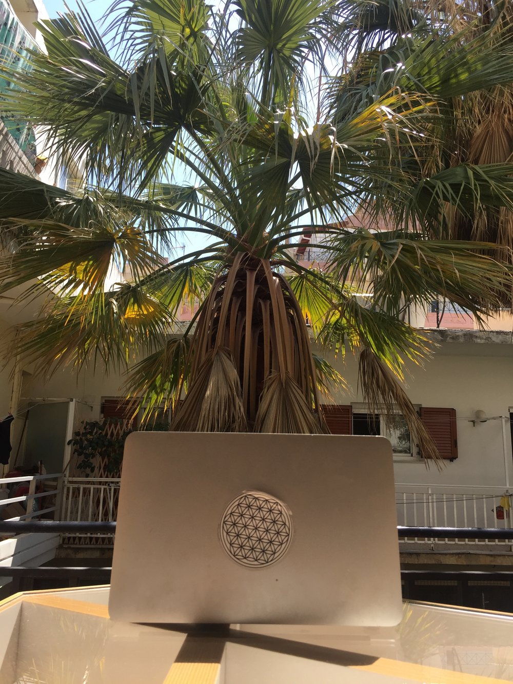Working in the sunshine on my balcony, in Crete (Greece).