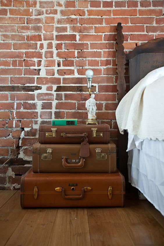 SUITCASES - Vintage suitcases make a great alternative! You can make them functional while putting your collection on display.