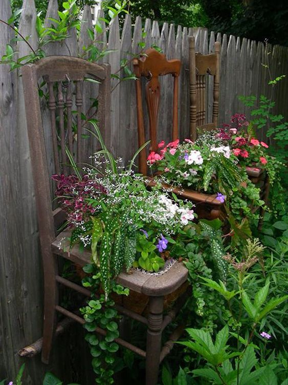 Chairs - Use your old chairs, or all of those garage sale finds, as planters. They would be a simple way to move your plants inside for the winter - straight from your fence to your walls!