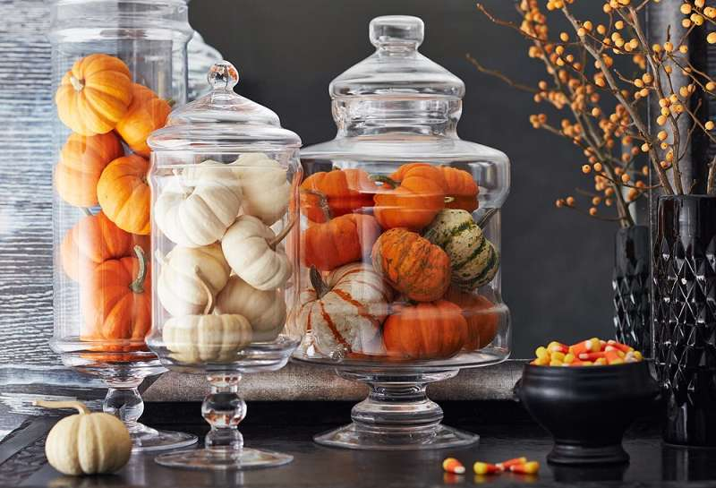 Apothecary Jars - Apothercary Jars are a great décor item to have year-round. Storing small pumpkins inside them is a great way to make any area feel a little more autumn-y. Not to mention that you can trade out the items inside with each passing season!
