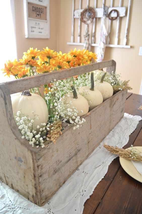 Tool Boxes - Antique wooden toolboxes are tucked away in every corner of The NAT. Adding some greenery and pumpkins make your tabletop really stand out!