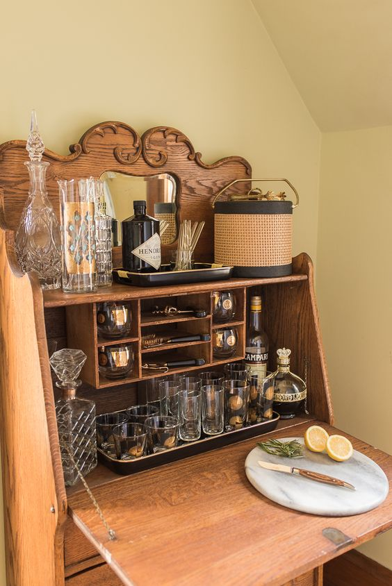 Repurpose, Reuse, and Refills - Repurposing is the name of the game when you shop for antiques. If you're looking for an outdoor bar to add to your patio, a vintage secretary might be the perfect fit.