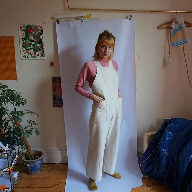 Retail mannequin in the comfort of her bedroom, wearing The Uniform from 'The Showroom' Capsule Collection 🍶  The Uniform: a unisex artist's overall available in small, medium and large 🖍 Made in collaboration with @sarahbelljones 🖍 £67.49 🖍 Edition of 40 🖍  #custommade #overall #uniform #capsulecollection #dungarees #shoppingcentre #mall #shopping #artobject #studio #suit #businesscasual