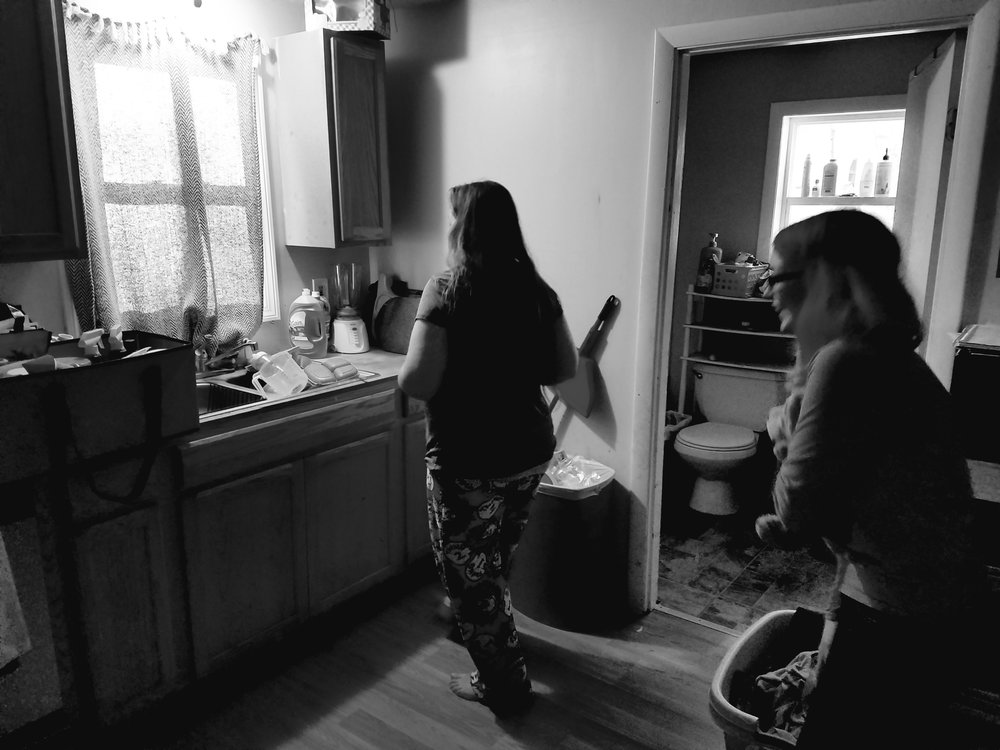 Tina and her oldest daughter in the kitchen of their house in Lisbon Falls (Maine Public photo by Susan Sharon)