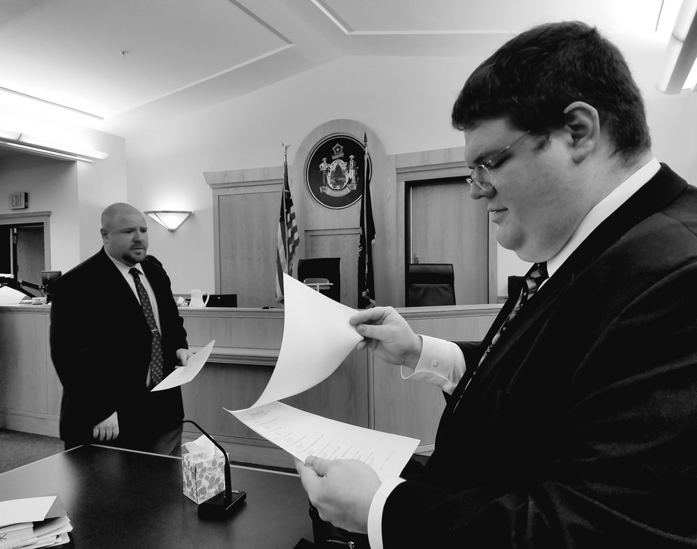 Pine Tree Legal Assistance attorney David Morse (right), in Courtroom No. 2 at Lewiston District Court. (Maine Public photo by Susan Sharon)
