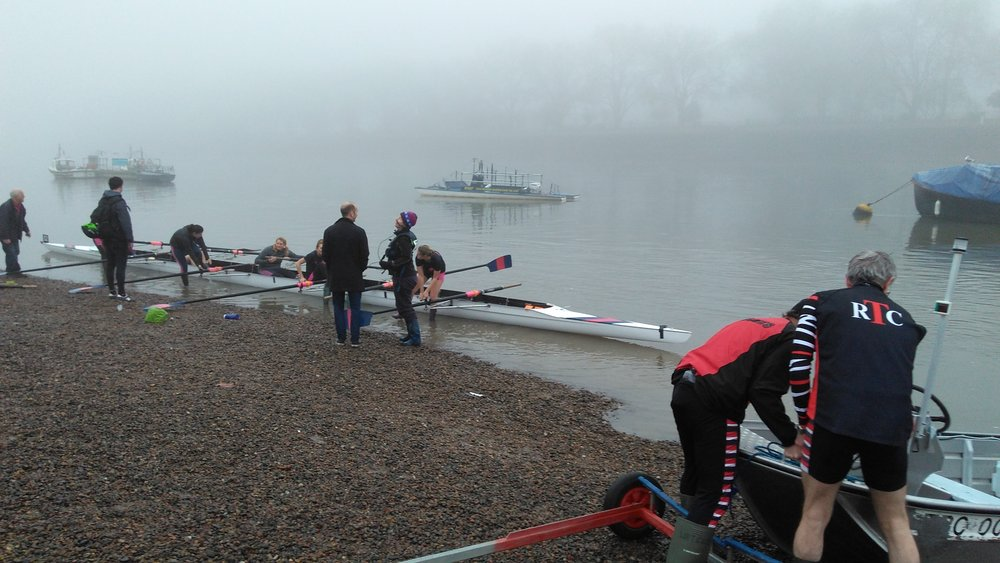 Elegantly (ha!) getting out of our boat after a mid-December foggy race on the Thames